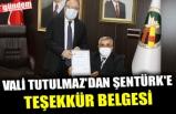 VALİ TUTULMAZ'DAN FİZİKSEL ENGELLİLER DERNEĞİ BAŞKANI ŞENTÜRK'E TEŞEKKÜR BELGESİ