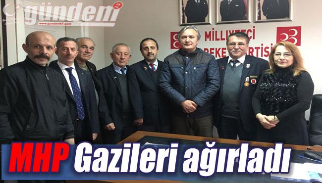 MHP Gazileri ağırladı