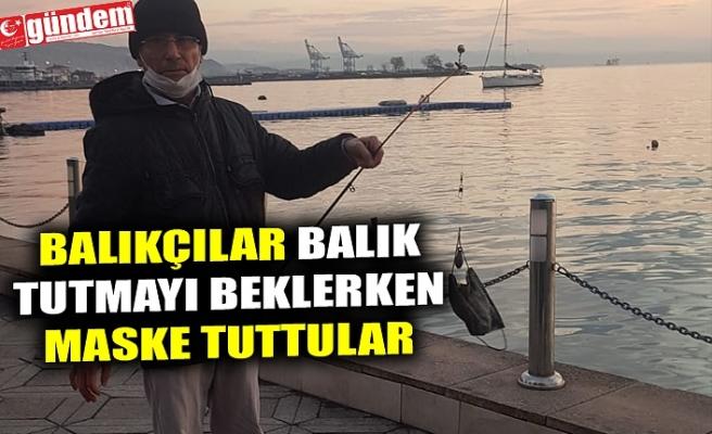 BALIKÇILAR BALIK TUTMAYI BEKLERKEN MASKE TUTtULAR