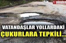 VATANDAŞLAR YOLLARDAKİ ÇUKURLARA TEPKİLİ...