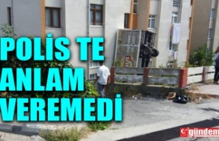 CİPS KAMYONU APARTMANLA YOL ARASINDA ASILI KALDI