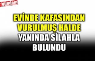 EVİNDE KAFASINDAN VURULMUŞ HALDE YANINDA SİLAHLA...