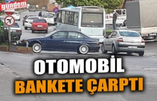 OTOMOBİL BANKETE ÇARPTI