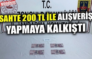 SAHTE 200 TL İLE ALIŞVERİŞ YAPMAYA KALKIŞTI