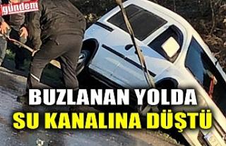 BUZLANAN YOLDA SU KANALINA DÜŞTÜ
