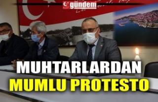 MUHTARLARDAN MUMLU PROTESTO