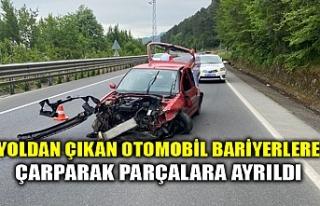YOLDAN ÇIKAN OTOMOBİL BARİYERLERE ÇARPARAK PARÇALARA...
