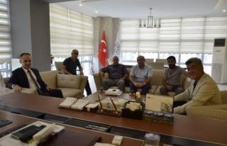 Kapusuz'dan Başkan Yiğit'e ziyaret